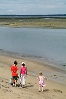 Four children on the beach at Arcachon Bay, Aquitaine, France.