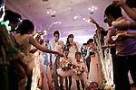 PHNOM PHEN, CAMBODIA, APRIL 2013:<br />Il Matrimonio di Tep Pongpich ( marito ), e Tep Monirat ( moglie ), nella Sala D a Diamond Island. <br /> &laquo;Voglio che tutto sia perfetto. L'ho fatto per la mia famiglia: non deve perdere la faccia con gli ospiti&raquo;, dice Monirath.<br /> L'alta borghesia khmer festeggia al Diamond Island Convention &amp; Exhibition Center, nuovo complesso creato su Koh Pich (Diamond Island), isola fluviale nel centro di Phnom Penh che nel sogno degli azionisti della Canadia Bank (tra cui, si mormora, la famiglia di Hun Sen, primo ministro in carica dal 1985) dovrebbe divenire una micro Singapore. Le dieci sale di Diamond Island possono accogliere un totale di 2000 persone, ma le tariffe sono molto pi&ugrave; alte: il minimo &egrave; di 250 dollari per un tavolo da dieci (cena compresa), la media di circa 400. &copy; Giulio Di Sturco per &quot;D&quot; della Repubblica