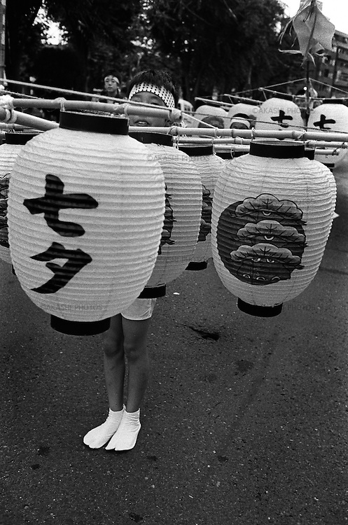 Kanto Festival in Akita. Children Men hold a 7 meter long bamboo with 24 Japanese paper lanterns which weigh about 15kg.