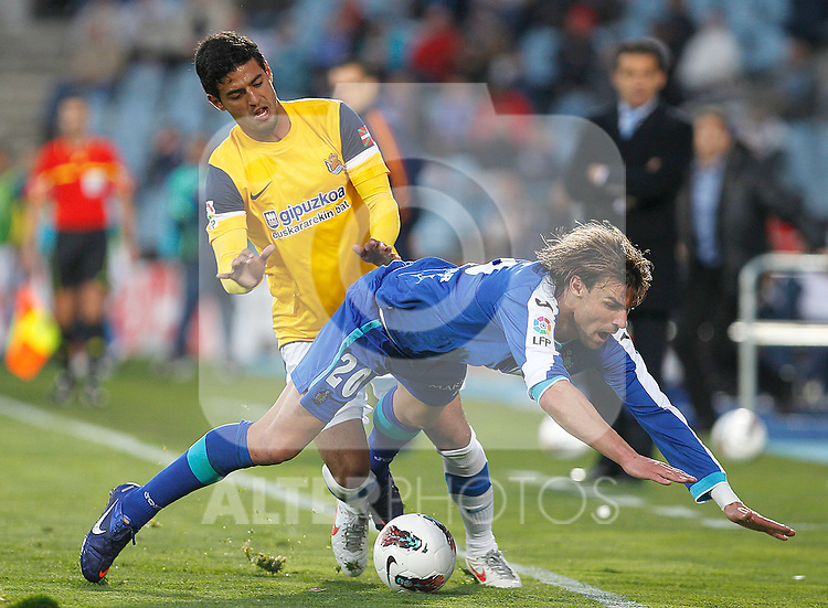 Getafe's Juan Valera (r) and Real Sociedad's Carlos Vela during La Liga match.March 17,2012. (ALTERPHOTOS/Acero)
