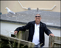 BNPS.co.uk (01202 558833)<br /> Pic: FinnbarrWebster/BNPS<br /> <br /> Seagull siege...<br /> <br /> A man is being kept hostage in his home by a family of angry seagulls who divebomb him every time he leaves the house.<br /> <br /> Chris Pritchard, who lives in Portland, Dorset, says he is terrified because of the vicious pair who are protecting their chick.<br /> <br /> He had been living in peace with the gulls for over a year since they started nesting on the roof but the nest was disturbed recently and the chick fell on to the ground.