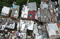 """BOGOTÀ, COLOMBIA - APRIL 19: Aerial view of the """"Egipto Alto"""" neighborhood in Bogota Colombia on April 19,2020. Government officials from several district authorities attached to Bogotá mayor's office distribute humanitarian aids provided with non-perishable food to inhabitants of Egipto Alto, a neighborhood belonging to Santa Fe County. Bogotá Solidaria campaign aims to benefit low-income families affected by  COVID19 pandemic.(Photo by Andres Moreno/VIEWpress via Getty Images)"""