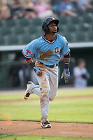 Franklin Rollin (40) of the Hickory Crawdads hustles down the first base line against the Kannapolis Intimidators in game one of a double-header at Kannapolis Intimidators Stadium on May 19, 2017 in Kannapolis, North Carolina.  The Crawdads defeated the Intimidators 5-4.  (Brian Westerholt/Four Seam Images)