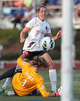 Portland Thorns FC forward Danielle Foxhoven (9) attack is thwarted by Boston Breakers goalkeeper Alyssa Naeher (1). In a National Women's Soccer League (NWSL) match, Boston Breakers (blue) defeated Portland Thorns FC (white/black), 2-1, at Dilboy Stadium on August 7, 2013.