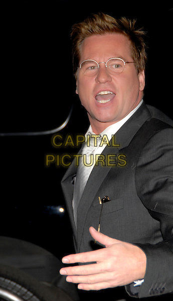 VAL KILMER.34th International Emmy Awards Gala at the New York Hilton, New York, NY, USA..November 20th, 2006.half length grey gray suit jacket glasses hand mouth open.CAP/ADM/PH.©Paul Hawthorne/AdMedia/Capital Pictures *** Local Caption ***