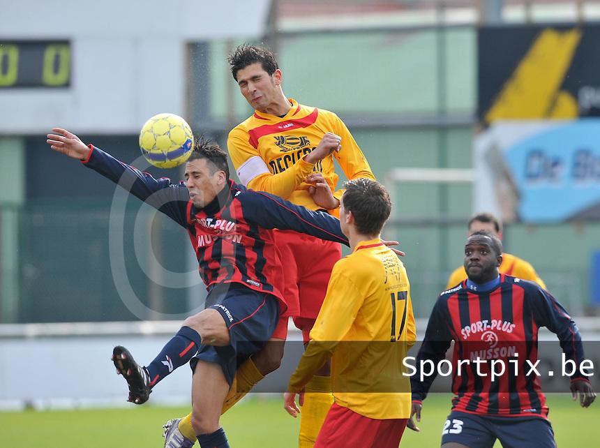 Racing Waregem - FC Bleid Gaume : Ouissem Zarti klimt hoger dan zijn belager Zouhair Brounou.foto VDB / Bart Vandenbroucke