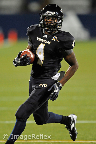 12 November 2011:  FIU wide receiver T.Y. Hilton (4) carries the ball in the first quarter as the FIU Golden Panthers defeated the Florida Atlantic University Owls, 41-7, to win the annual Shula Bowl game, at FIU Stadium in Miami, Florida.