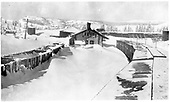 Broad winter view from top of box car east of D&amp;RG Cumbres depot showing fresh, deep, snow.  Several gondolas are stranded in the snow at left, while a string of box cars appears to be in the clear at right.<br /> D&amp;RG  Cumbres, CO  Taken by Lively, Charles R. - ca. 1909-1915