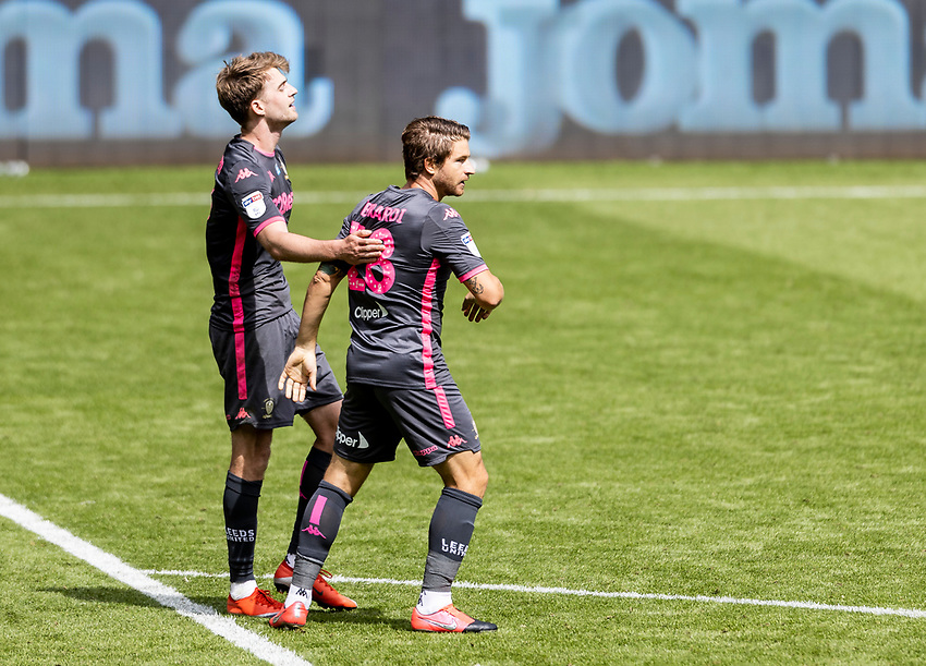 Leeds United's Patrick Bamford celebrates victory with team mate Gaetano Berardi (right) <br /> <br /> Photographer Andrew Kearns/CameraSport<br /> <br /> The EFL Sky Bet Championship - Swansea City v Leeds United - Sunday 12th July 2020 - Liberty Stadium - Swansea<br /> <br /> World Copyright © 2020 CameraSport. All rights reserved. 43 Linden Ave. Countesthorpe. Leicester. England. LE8 5PG - Tel: +44 (0) 116 277 4147 - admin@camerasport.com - www.camerasport.com