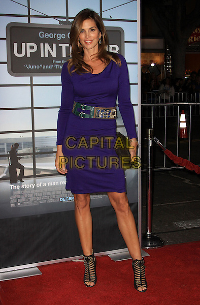 "CINDY CRAWFORD.""Up In The Air"" Los Angeles Premiere held At Mann Village Theatre. Resort . Spa, Westwood, California, USA..November 30th, 2009.full length purple dress strappy open toe sandals purple dress belt clutch bag black.CAP/ADM/KB.©Kevan Brooks/AdMedia/Capital Pictures."