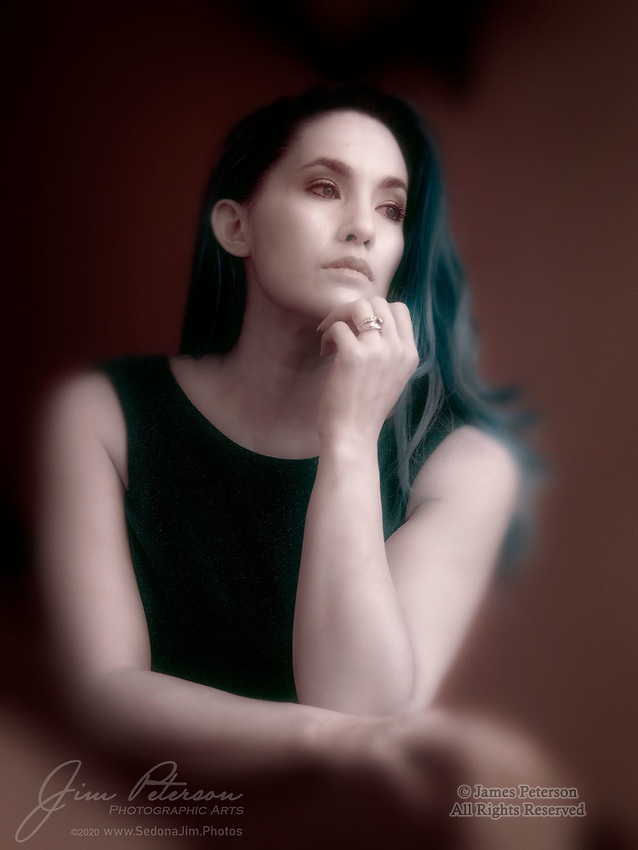 """The Pensive One (Infrared).  The beautiful Cherie is one remarkable, and remarkably upbeat, lady.  She's a working mom who (with her husband) rises to the many challenges of raising a LARGE family (I've lost count, but they have several biological kids plus multiple adopted kids and young fosters).  And as if that weren't enough, she excels as a professional fashion model as well.  All of which gives her plenty to contemplate during quiet moments while posing for photos, as she was doing here during a """"meet and greet"""" session hosted by Red Bench Photo Studio in Jerome, Arizona.<br /> <br /> Image ©2020 James D. Peterson"""