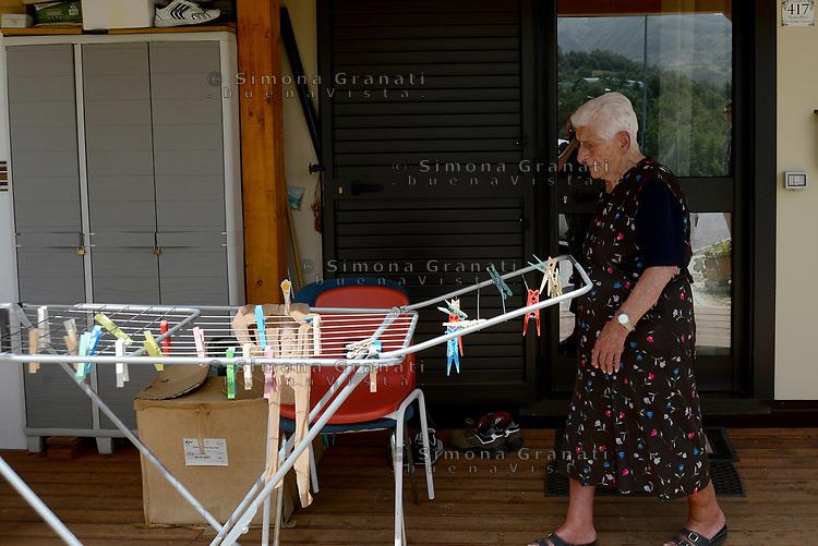 Accumoli, Rieti, 11 Giugno 2018<br /> Donna anziana<br /> Il Presidente del Consiglio Giuseppe Conte in visita sui luoghi del terremoto del 24 Agosto 2016