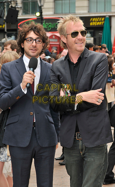 "ALEX ZANE & RHYS IFANS .UK Film Premiere of ""Toy Story 3"", Odeon Leicester Square, London, England, UK..July 18th 2010.half length grey gray suit jacket glasses sunglasses shades arms crossed microphone .CAP/CAN.©Can Nguyen/Capital Pictures."