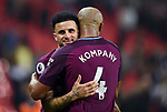 Vincent Kompany of Manchester City and Kyle Walker of Manchester City celebrate at the end of the premier league match at the Wembley Stadium, London. Picture date 14th April 2018. Picture credit should read: Robin Parker/Sportimage