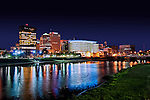 Dayton Ohio skyline photo at night with river and cityscape