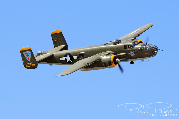 """A North American B-25 Mitchell in flight during the 2007 Warbirds in Action Airshow at Minter Field near Shafter, California. Serial #44-30748 was first delivered to the USAAF in 1944 and later flew as a sprayer in Wyoming before landing the role of """"M&M"""" and """"Miss Renee"""" in the movie version of the Joseph Heller novel 'Catch 22.'"""