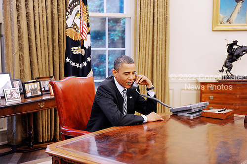 United States President Barack Obama makes a phone call to congratulate the new British Prime Minister David Cameron, in the Oval Office of the White House in Washington, DC, on Tuesday, May 11, 2010. .Credit: Olivier Douliery / Pool via CNP