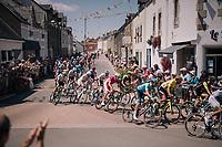 peloton rolling through the town of St-Lyphard<br /> <br /> Stage 4: La Baule &gt; Sarzeau (192km)<br /> <br /> 105th Tour de France 2018<br /> &copy;kramon