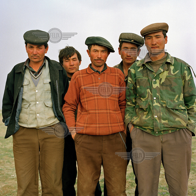 Five Uighur shepherds near the Cherchen Daria (Cheerchenghe) river. Walking 850 km in 34 days, Yann Mingard followed in the footsteps of explorers Ella Maillart and Peter Fleming, who travelled part of the Silk Road through Eastern Turkestan in 1935.