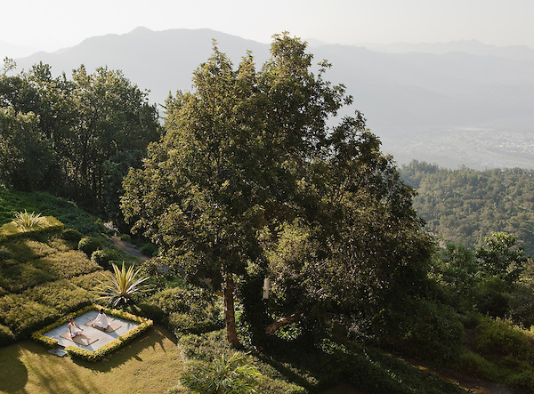 A private morning yoga lesson in the backyard garden of the Ananda Suite, Ananda in the Himalayas, The Palace Estate, Narendra Nagar, Tehri Garhwal, Uttarakhand, India. The backyard garden offers views of Rishikesh and the Ganges River below.