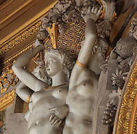 Caryatids in carved stucco from the frame of the Anaux fresco by Rosso Fiorentino, 1535-37, on the North wall of the Galerie Francois I, begun 1528, the first great gallery in France and the origination of the Renaissance style in France, Chateau de Fontainebleau, France. The Palace of Fontainebleau is one of the largest French royal palaces and was begun in the early 16th century for Francois I. It was listed as a UNESCO World Heritage Site in 1981. Picture by Manuel Cohen