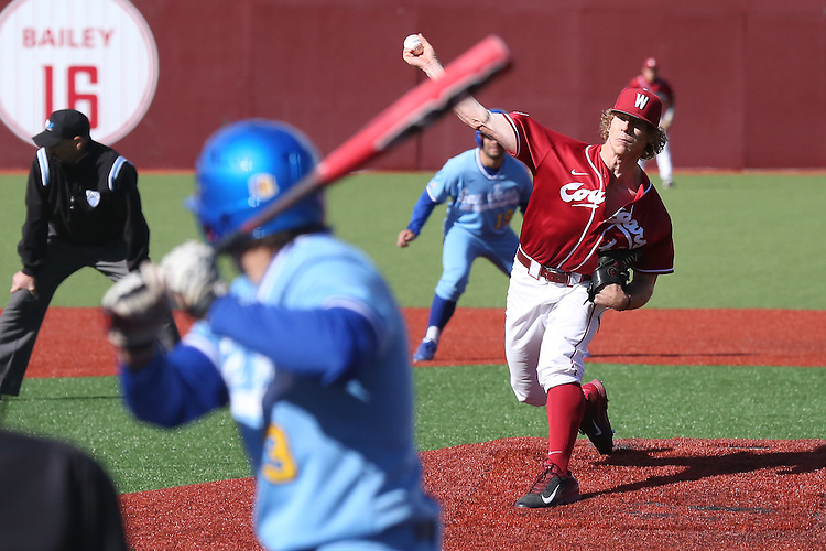 Ian Hamilton delivers to the plate during Washington State's non-conference battle with San Jose State at Bailey-Brayton Field in Pullman, Washington, on May 24, 2014.  The Cougars came back to defeat the Spartans, 12-9.