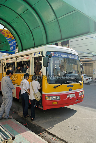 Asia, Vietnam, Nha Trang. Entering a public bus.