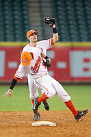 Sam Houston State Bearkats second baseman Ryan Farney #9 catches a pop fly in front of shortstop Jake MacWilliam #10 during the game against the Texas Longhorns at Minute Maid Park on March 2, 2014 in Houston, Texas.  The Longhorns defeated the Bearkats 3-2 to finish the tournament 3-0.  (Brian Westerholt/Four Seam Images)