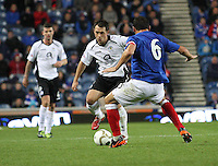 Derek Young takes on Lee McCulloch in the Rangers v Queen of the South Quarter Final match in the Ramsdens Cup played at Ibrox Stadium, Glasgow on 18.9.12.