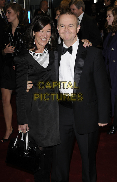"VICTORIA & IAN HISLOP.World Premiere of ""Bunch of Amateurs"" at the Odeon, Leicester Square London, England..November 17th 2008.full length black tuxedo jacket 3/4 dress bag purse married husband wife .CAP/CAN.©Can Nguyen/Capital Pictures."