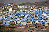 Morning light illuminates the MEHERANGARH FORT WALL and JOHDPUR also known as the BLUE CITY - RAJASTHAN, INDIA