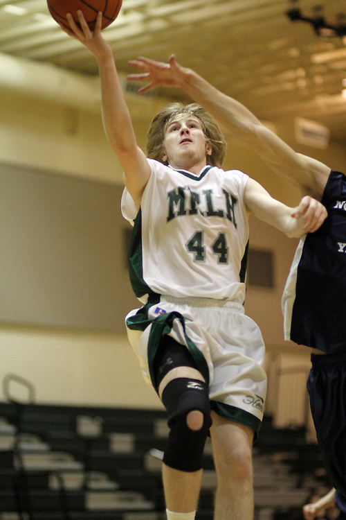 Photograph from the 2010-11 Mt. Rainier Lutheran High School boy's basketball season.
