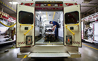 NWA Democrat-Gazette/JASON IVESTER <br /> Rogers probationary firefighter Tyler FInley performs a routine daily check on Friday, Sept. 11, 2015, inside the Medic 1 ambulance at Rogers Fire Station 1.