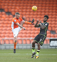 Blackpool's Jay Spearing battles with Bristol Rovers' Ellis Harrison<br /> <br /> Photographer Mick Walker/CameraSport<br /> <br /> The EFL Sky Bet League One - Blackpool v Bristol Rovers - Saturday 13th January 2018 - Bloomfield Road - Blackpool<br /> <br /> World Copyright &copy; 2018 CameraSport. All rights reserved. 43 Linden Ave. Countesthorpe. Leicester. England. LE8 5PG - Tel: +44 (0) 116 277 4147 - admin@camerasport.com - www.camerasport.com