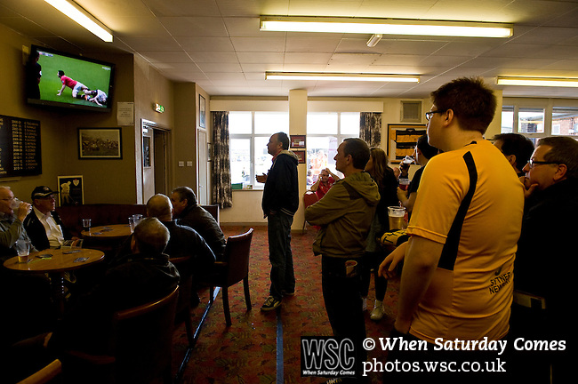 Newport County 1 Exeter City 1, 16/03/2014. Rodney Parade, League Two. Newport County finally return to the Football league after years of turmoil but a poor run of results has dented hopes of reaching the play-offs while Exeter City battle relegation. Newport County fans watching the rugby in the bar before the game. Photo by Simon Gill