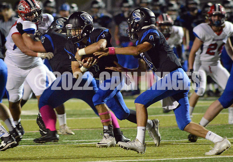 Central Bucks South's Jack Consoletti (4) (right) hands off to Ryan Watson (1) who runs for a short gain against Neshaminy in the first quarter Friday, October 06, 2017 at Central Bucks South in Warrington, Pennsylvania. (WILLIAM THOMAS CAIN / For The Philadelphia Inquirer)