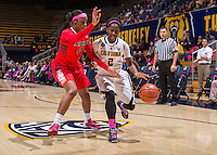 California's Afure Jemerigbe tries to dribble around Arizona's Farrin Bell during a  game at Haas Pavilion in Berkeley, California on February 14th, 2014. California defeated Arizona 65 - 49