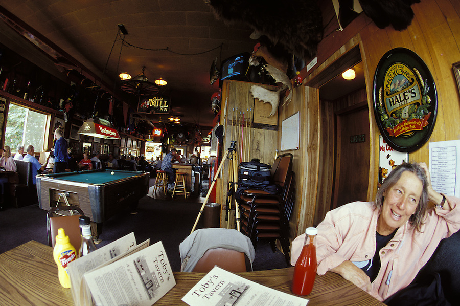 Woman relaxing in Toby's Tavern, Coupeville, Whidbey Island, Washington