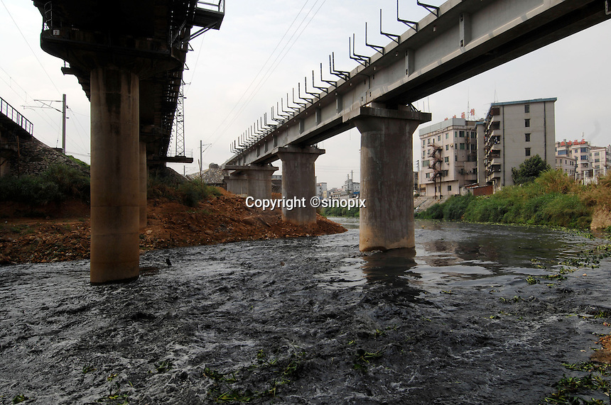 The black and dead Tangxia River is filled with industrial waste in Guangdong Province, China. Tangxia is a heavily polluted town..20 Mar 2007