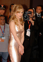 """NICOLE KIDMAN.Attends the film premiere of """"Fur: An Imaginary Portrait of Diane Arbus""""  during the first day of the Rome Film Festival, Roma, Italy,.October 13th 2006..half length red carpet pale pink silver gold shimmery shiny sequined dress hands clasped together twisted tight  fringe hair.Ref: CAV.www.capitalpictures.com.sales@capitalpictures.com.©Luca Cavallari/Capital Pictures."""