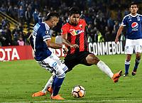 BOGOTA - COLOMBIA – 17 - 04 - 2018: Juan Guilermo Dominguez (Izq.) jugador de Millonarios (COL), disputan el balon con Jesus Hernandez (Der.) jugador de Deportivo Lara (VEN), durante partido entre Millonarios (COL) y Deportivo Lara (VEN), de la fase de grupos, grupo G, fecha 3 de la Copa Conmebol Libertadores 2018, en el estadio Nemesio Camacho El Campin, de la ciudad de Bogota. / Juan Guilermo Dominguez (L) player of Millonarios (COL), fights for the ball with Jesus Hernandez (R) player of Deportivo Lara (VEN), during a match between Millonarios (COL) and Deportivo Lara (VEN), of the group stage, group G, 3rd date for the Conmebol Copa Libertadores 2018 in the Nemesio Camacho El Campin stadium in Bogota city. VizzorImage / Luis Ramirez / Staff.