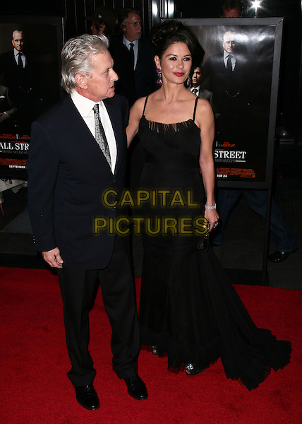MICHAEL DOUGLAS & CATHERINE ZETA JONES.Premiere of 'Wall Street: Money Never Sleeps' at the Ziegfeld Theatre on September 20, 2010 in New York City, New York, NY, USA..September 20th, 2010.full length suit jacket black white dress white shirt married husband wife navy blue maxi profile .CAP/ADM/PZ.©Paul Zimmerman/AdMedia/Capital Pictures.
