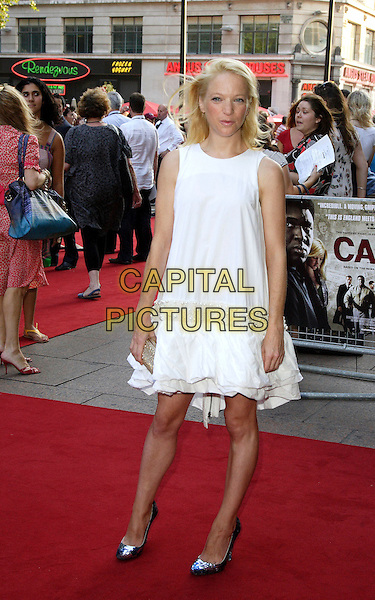 "NATHALIE PRESS.UK Film Premiere of ""Cass"" held at the Empire cinema , Leicester Square, London, England, July 28th 2008..full length white dress gold clutch bag silver shoes .CAP/ROS.©Steve Ross/Capital Pictures"