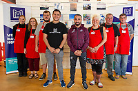 Pictured: Leon Britton (centre right) with Thom Lynch (centre left) project manager, and the volunteers at Matthews house. Thursday 06 September 2018