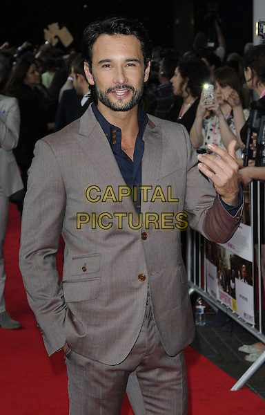 Rodrigo Santoro.The 'What To Expect When You're Expecting' UK film premiere, BFI Imax cinema, London, England..May 22nd, 2012.half length blue shirt grey gray suit beard facial hair hand.CAP/CAN.©Can Nguyen/Capital Pictures.