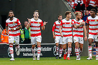 John Marquis of Doncaster Rovers (2nd left) celebrates after he scores his team's second goal of the game to make it 2-1 during the Sky Bet League 2 match between Doncaster Rovers and Wycombe Wanderers at the Keepmoat Stadium, Doncaster, England on 29 October 2016. Photo by David Horn.