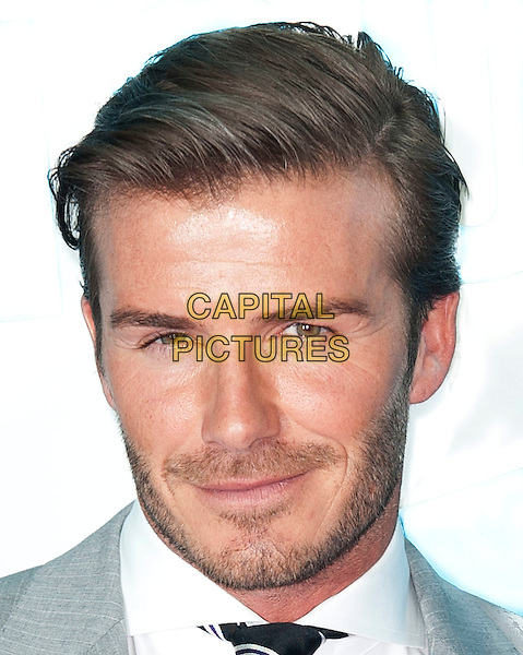 David Beckham .Samsung kicks-off its London 2012 campaign 'Everyone's Olympic Games', Canary Wharf, London, England..13th June 2011.portrait headshot grey gray stubble beard facial hair black white tie .CAP/CAS.©Bob Cass/Capital Pictures.