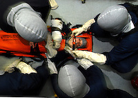 080507-N-7981E-043 ARABIAN GULF (May 7, 2008)- ARABIAN GULF (May 7, 2008)- Stretcher bearers from Repair Locker 3 prepare a simulated casualty for transport to main medical during a General Quarters (GQ) drill aboard Nimitz-class aircraft carrier USS Abraham Lincoln (CVN 72).  Lincoln is deployed to the U.S. Navy 5th Fleet area of responsibility to support Maritime Security Operations (MSO).  MSO help develop security in the maritime environment, which promotes stability and global prosperity.  These operations complement the counterterrorism and security efforts of regional nations and seek to disrupt violent extremists' use of the maritime environment as a venue for attack or to transport personnel, weapons or other material.  U.S. Navy Photo by Mass Communication Specialist 2nd Class James R. Evans (RELEASED)