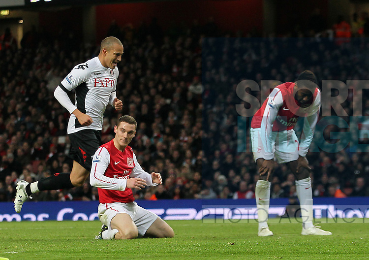 Arsenals Thomas Vermaelen looks on dejected after scoring an own goal to put Fulham 1-0 up