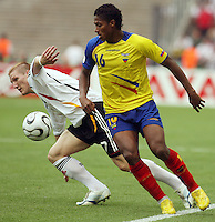 Germany's Bastian Schweinsteiger (7) and Ecuador's Luis Valencia (16) chase after the ball. Germany defeated Ecuador 3-0 in their FIFA World Cup Group A match at Olympiastadion, Berlin, Germany, June 20, 2006.
